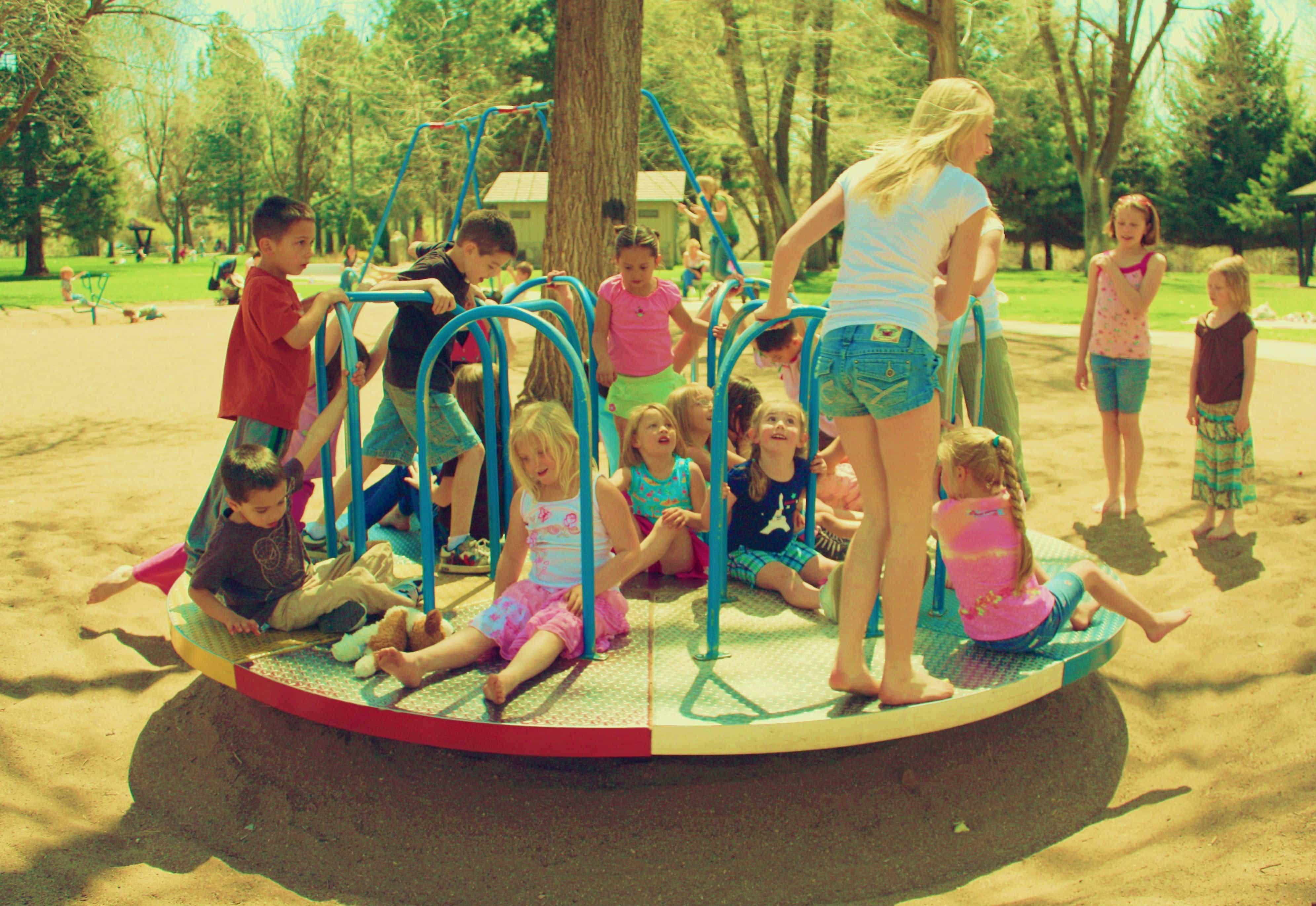 Children Playing on merry go round