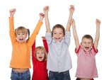 happy kids with hands in the air