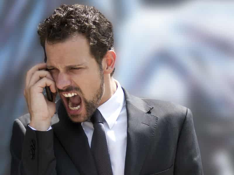 A person reacting spontaneously on the phone.